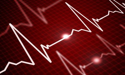 EKG-kurvor mot roed bakgrund