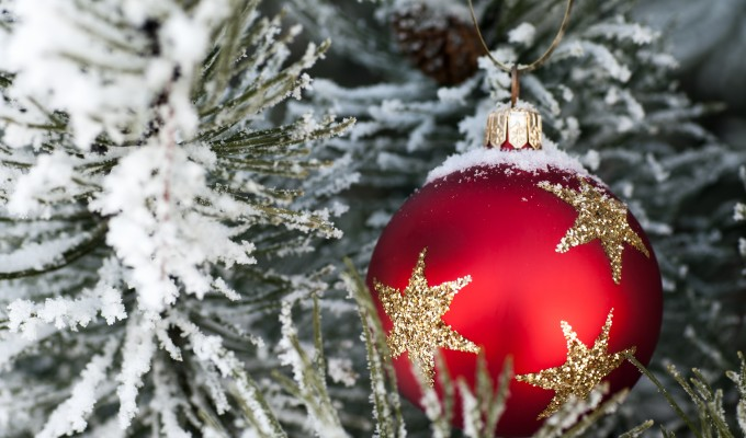 Snow on red christmas bauble