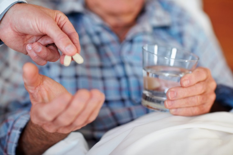 Closeup of an elderly man being given pills_dreamstime_11312558