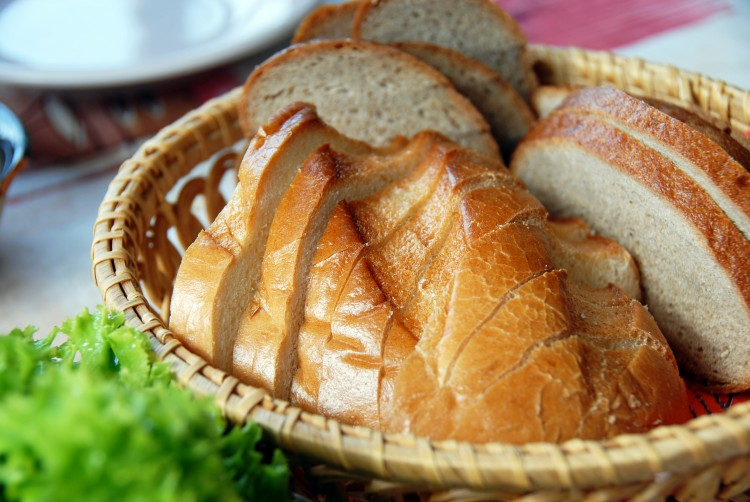 white bread slices served in wicker utensil served on table