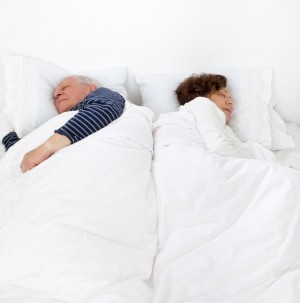 Senior couple in bed asleep_dreamstime_13822577