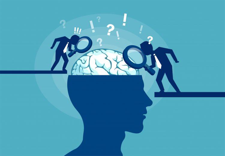 Ett stiliserat huvud med övre halvan av skallen borttagen så att hjärnan syns. Två streckgubbar står bredvid och studerar hjärnan med förstoringsglas