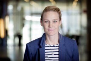 Porträttbild av My Engström. Hon har långt mörkblonts hår som är uppsatt i en knut eller hästsvas. Hon är klädd i en blå kavaj och en blå-vit-randig tröja